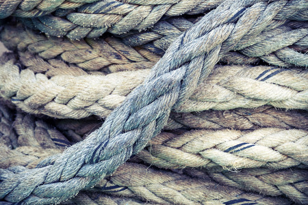 Gray nautical rope, closeup background texture, vintage toned photo with retro style filter
