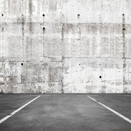 Abstract empty parking interior background with road marking and white concrete wall photo