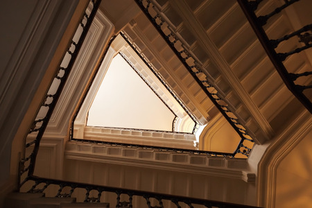 triangle shaped: Abstract interior fragment, triangle shaped flight of stairs, looking up