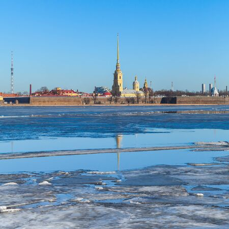 Winter landscape with floating ice on Neva river. Peter and Paul fortress in St. Petersburg, Russia