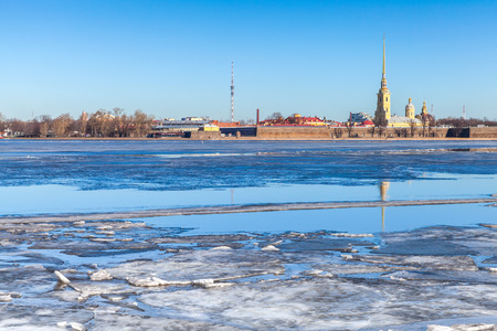Winter landscape with floating ice on Neva river. Peter and Paul fortress in Saint-Petersburg, Russia