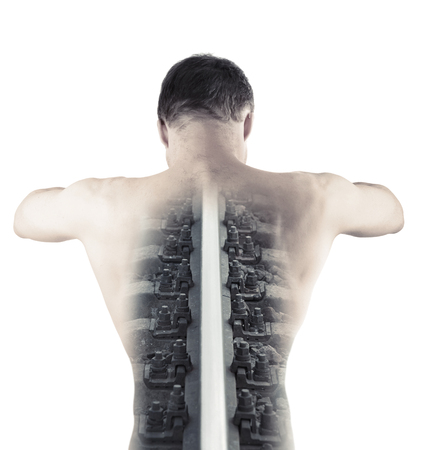 Double exposure monochrome abstract conceptual collage with railway rail as a backbone of muscular young male, back view isolated on white background photo