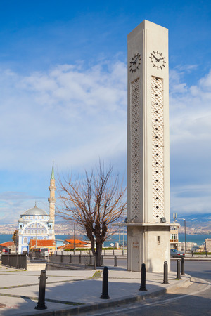 camii: Izmir, Turkey - February 12, 2015: Modern clock tower and Fatih Camii (Esrefpasa), old mosque, Izmir, Turkey Editorial