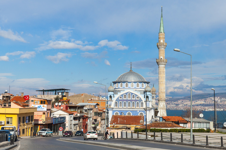camii: Izmir, Turkey - February 12, 2015: Street view of Birlesmis Milietler Cd. with Fatih Camii (Esrefpasa) old mosque, Izmir, Turkey