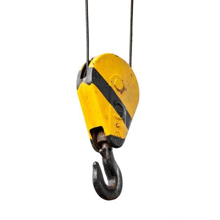 Crane hook hanging on steel ropes isolated on white background