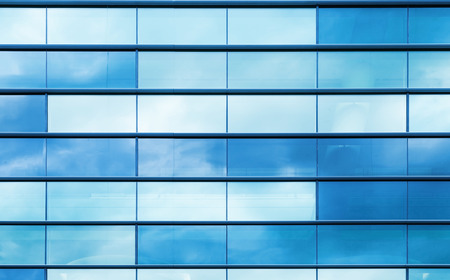 office building: Modern office building wall made of blue glass and steel frame, background texture