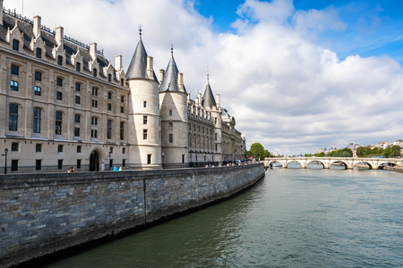 part prison: Conciergerie castle is a former royal palace and prison in Paris, France. Today it is a part of the popular complex known as the Palais de Justice. It is located on  the Cite Island Stock Photo
