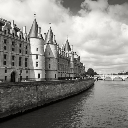 part prison: Conciergerie castle is a former royal palace and prison in Paris, France. Today it is a part of the popular complex known as the Palais de Justice. Black and white square photo
