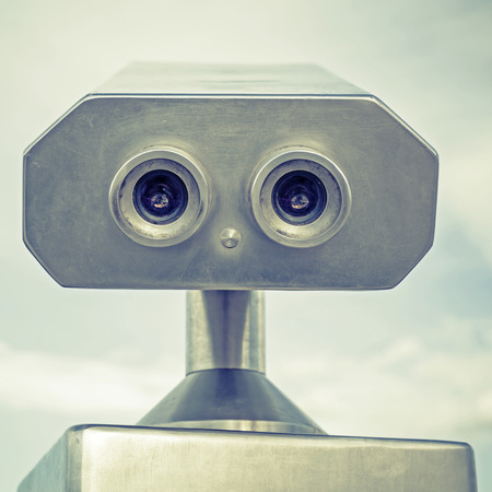 lens unit: Paid outdoor tourist telescope made of stainless steel looks like a robot portrait. Vintage stylized photo with old style green toned filter effect Stock Photo
