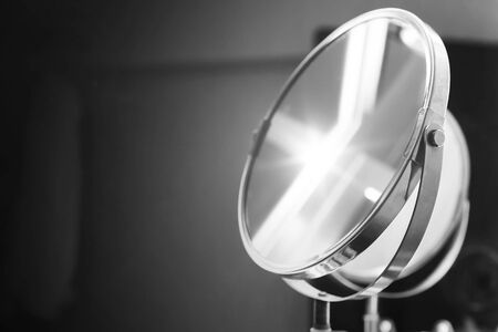 wall mirror: Round bathroom mirror with illumination, black and white monochrome photo Stock Photo