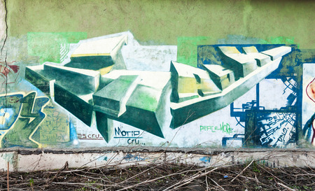Saint-Petersburg, Russia - April 6, 2015: Graffiti fragment with colorful chaotic elements on old green concrete wall Editorial