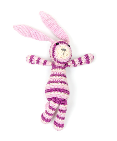 Funny knitted rabbit toy isolated on white background with soft shadow photo