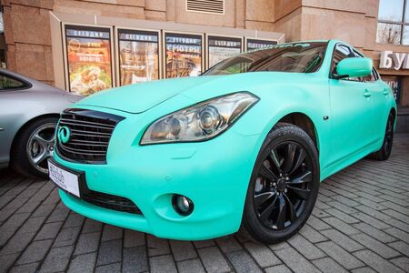 fx: Saint-Petersburg, Russia - April 11, 2015: Infinity fx 37 car with green matte paintings stands parked on the street
