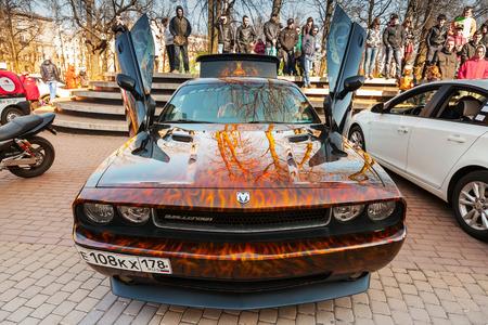 challenger: Saint-Petersburg, Russia - April 11, 2015: Dodge challenger with aggressive street race design stands with open doors, front view