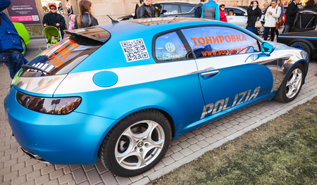 romeo: Saint-Petersburg, Russia - April 11, 2015: Blue Afla Romeo Brera car with silver paintings elements and police text label