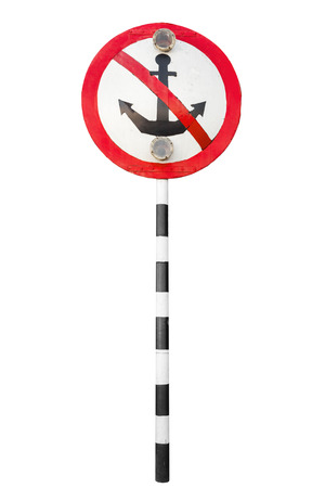 black moor: Mooring prohibited, round navigation sign with strikeout anchor on striped metal pole isolated on white