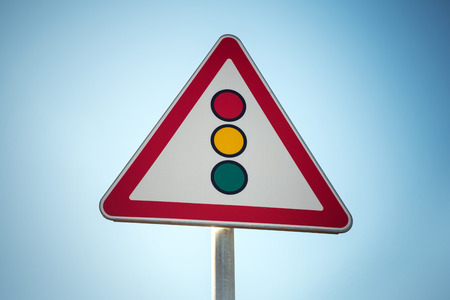 tonal: Traffic lights. Triangle road sign over blue sky background. Photo with vintage tonal correction filter Stock Photo