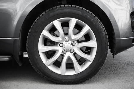 aluminum wheels: Modern automotive wheel on gray light alloy disc