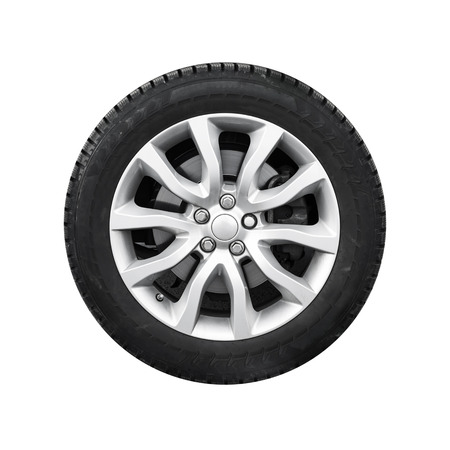 New shiny automotive wheel on light alloy disc isolated on white background