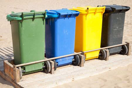 garbage collection: Colorful plastic containers in a row for separate garbage collection