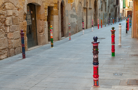Tarragona, Spain - August 16, 2014: Street view of Spanish Tarragona city. Artistic colorful metal poles on roadsides Editorial