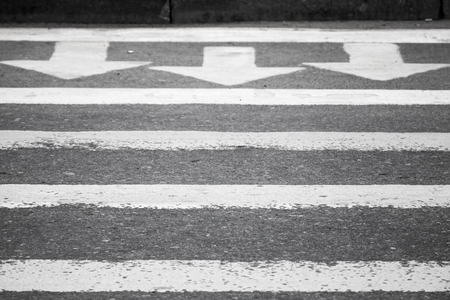 Three white arrows and lines on dark gray asphalt road, pedestrian crossing road marking photo