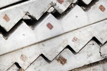 Abstract industrial construction background. Gray concrete stairway elements are stacked outdoor photo