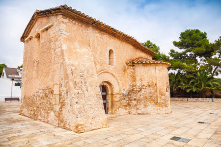 apses: Saint Michael church in Calafell town, Spain. It is a work of transaction from Romanic to Gothic style, was shaped in XIII century, has two apses, one consecrated to St. Miahael, another to St. Mary