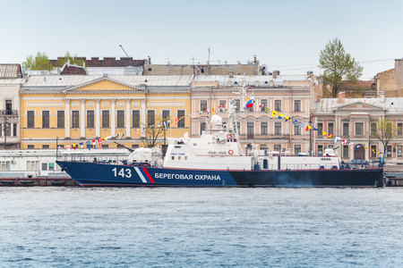 border patrol: SaintPetersburg Russia May July 2015: Russian Maritime Border Guard Svetlyak class patrol craft PSKR913 stands on the Neva River in anticipation of the military parade of naval forces
