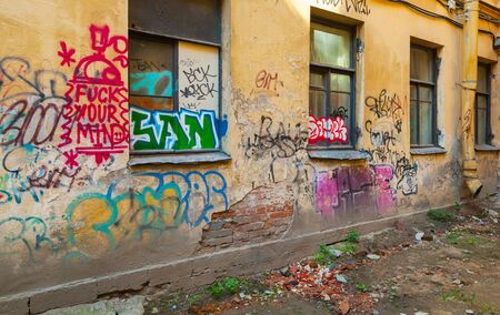 window graffiti: Saint-Petersburg, Russia - May 6, 2015: Abandoned urban courtyard with abstract graffiti  on damaged wall with window. Vasilievsky island, St. Petersburg