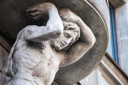 sculpt: Sculpture of Atlas on the facade of the old building in Saint-Petersburg, Russia. The house on Kamennoostrovsky, 29 it was built in 1912-1914 by Dolginov architect project