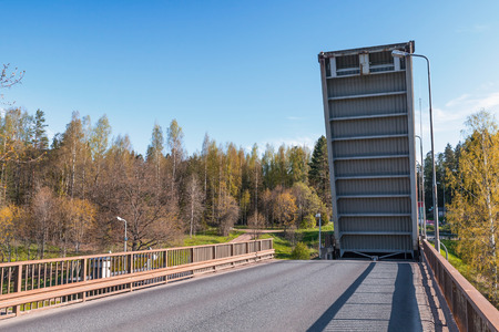 canal lock: Open drawbridge over Tsvetochnoye lock on the Saimaa Canal, a transportation canal that connects lake Saimaa with the Gulf of Finland near Vyborg, Russia Stock Photo