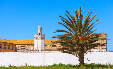 ourdoor: Abandoned buildings with mosque near the avenue Mohammed VI in Tangier city, Morocco