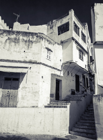 ourdoor: Narrow Arabic streets, old Medina of Tangier, Morocco. Monochrome hi contrast filter effect Stock Photo