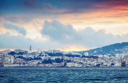 Bright sunset sky over Tangier city, Morocco, Africa. Colorful vintage photo filter effect