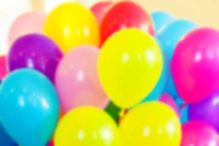 tonal: Group of colorful balloons, blurred photo background with vintage tonal photo filter effect, retro style