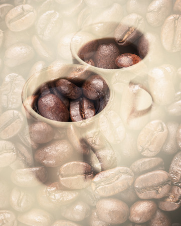 Two white coffee cups over dark rusted coffee beans texture. Double exposure photo with vintage style tonal photo filter effect photo