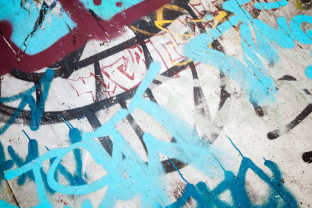 tonal: Abstract colorful graffiti fragment over old urban concrete wall, vintage tonal photo filter effect, retro style