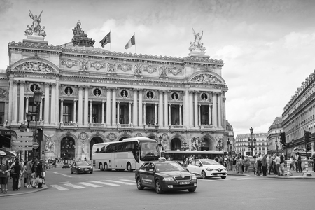 palais garnier: Paris France August September 2014: Palais Garnier old Opera house in Paris with walkink people and cars on the street monochrome photo
