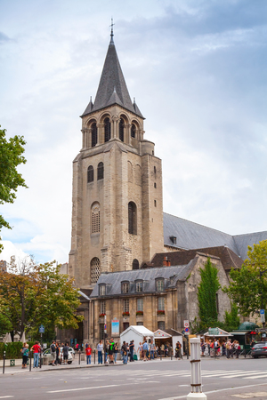 pres: Paris France August October 2014: Abbey of SaintGermaindesPres tourists walk near popular landmark of Paris Editorial