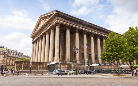 the madeleine: Paris France August September 2014: La Madeleine church exterior with walking tourists on the street Editorial