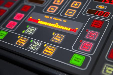 electronics equipment: Fragment of illuminated ship control panel on the captain bridge in the dark. Selective focus, shallow DOF