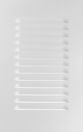 grille': White metal industrial panel with ventilation grille