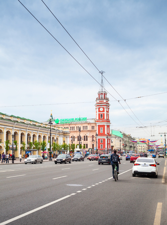 Saint-Petersburg, Russia - May 26, 2015: Nevsky prospect, vertical cityscape with the Great Gostiny Dvor facade and clock tower in St. Petersburg