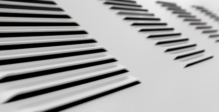 grille: White metal industrial wall with ventilation grille, closeup photo with selective focus and shallow DOF