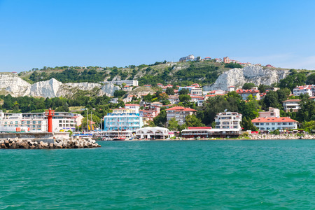 balchik: Coastal landscape of Balchik resort town. Entrance to port, red lighthouse on the pier. Coast of the Black Sea, Varna region, Bulgaria Editorial