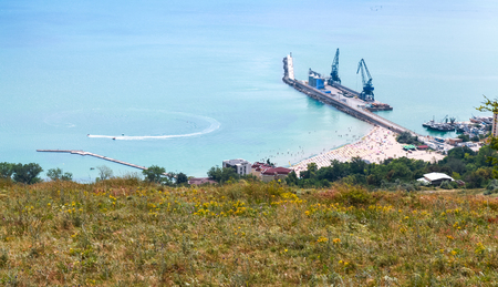 balchik: Cargo port terminal with cranes on pier. Balchik resort town, coast of Black Sea, Bulgaria