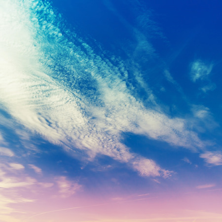 tonal: Bright cloudy sky, stylized background photo texture with tonal filter correction