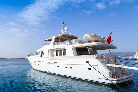 White pleasure motor yacht stands moored in Izmir city, Turkey