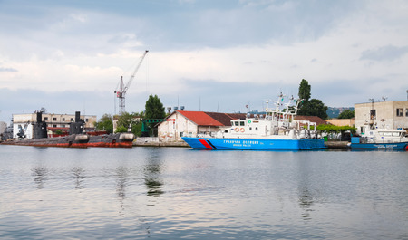 border patrol: Varna, Bulgaria - July 16, 2014: Bulgarian border police ships stand moored in Varna port